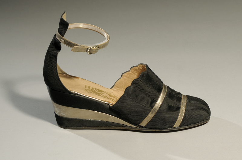 Evening wedge by Salvatore Ferragamo, black silk ottoman and satin with silver kid, circa 1940, Italy. Gift of Mrs. Robert G. McKay.