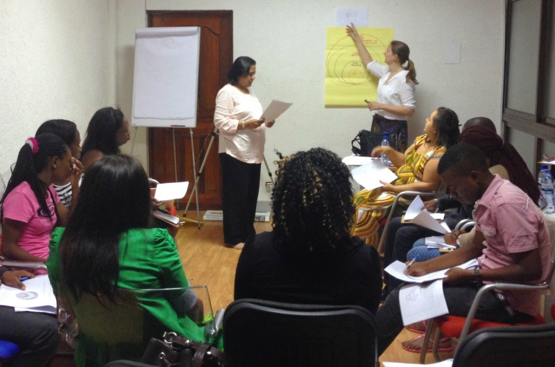 Suruchi Sood and Amy Henderson Riley training employees in Mozambique.