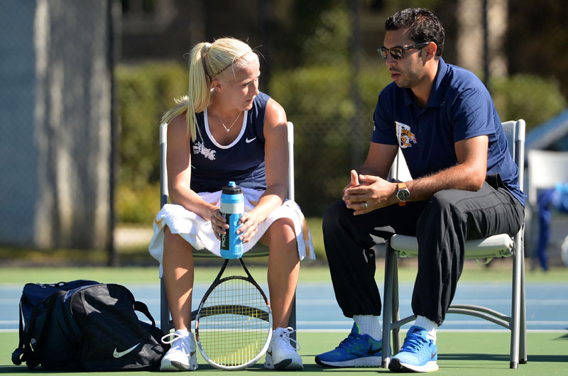Mehdi Rhazali (R), head tennis coach at Drexel, talks with a student-athlete.
