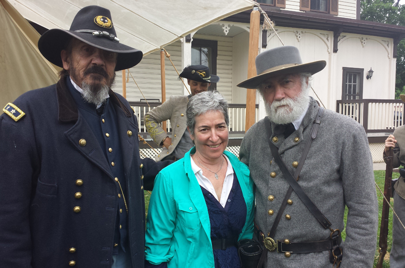 Drexel's Tobie Hoffman, center, with re-enactors playing the Union's General George Meade, left, and the Confederacy's Robert E. Lee, right.