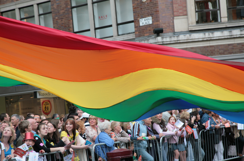 Rainbow Flag during a Pride event. Photo by Jez Atkinson.