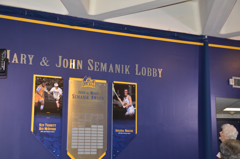 Semanik admiring the newly adorned wall in the Daskalakis Athletic Center named after her and her late husband, John.