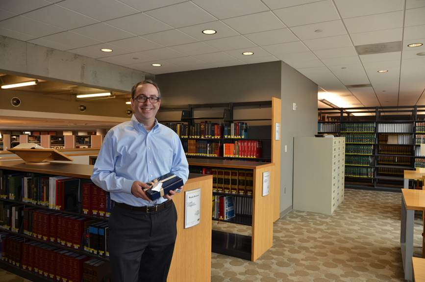 Daniel M. Filler, JD, senior associate dean for Academic and Faculty Affairs in the Kline School of Law, holding the iPad he won as a part of a drawing for taking part in the 2014-15 Why I Give campaign.