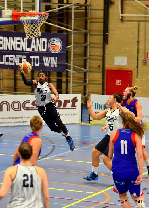 Drexel's Alexis Smith driving to the basket against Binnenland Rotterdam. Photo courtesy of Ruud Fokke.