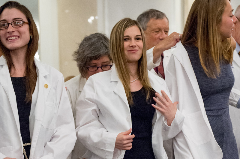 Drexel students in the College of Medicine receive their first white coats as part of an annual ceremony.