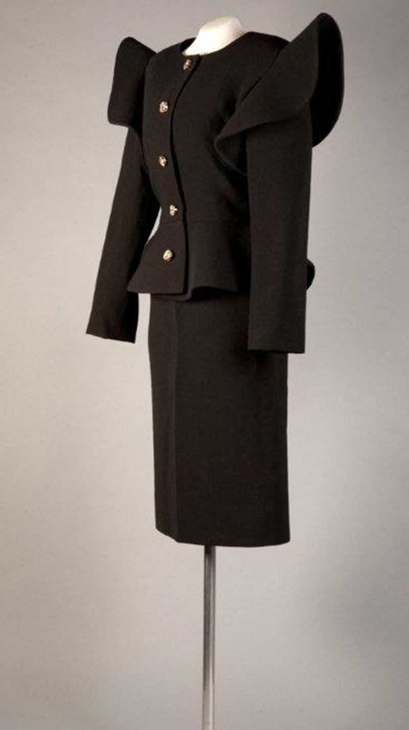 Pierre Cardin, black wool crepe, c. 1983, France. Gift of Katherine Field.