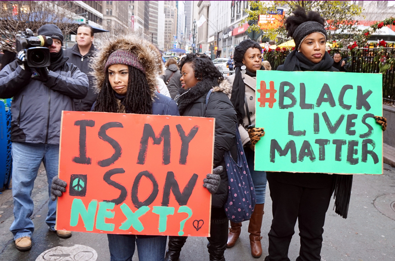 Protestors carrying placards at a Black Lives Matter demonstration in New York City in Nov. 2014.