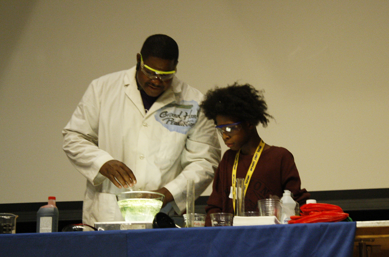 """Hip hop"" scientist Grand Hank doing an experiment with a member from the audience."
