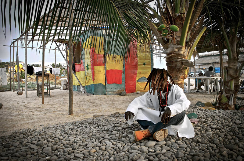 Man resting in Dakar, Senegal, by Meghan Maguire