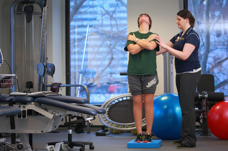 Sara Tomaszewski, a clinical instructor for physical therapy at Parkway Health & Wellness, works with a patient in the new 23,000-square-foot space in Center City.