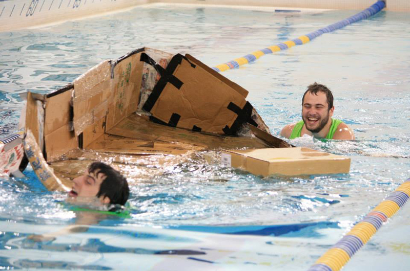 One of the less-than-succesful teams in 2014's Rec Recycle Regatta with the remains of their cardboard boat. Courtesy of Drexel Recreational Athletics.