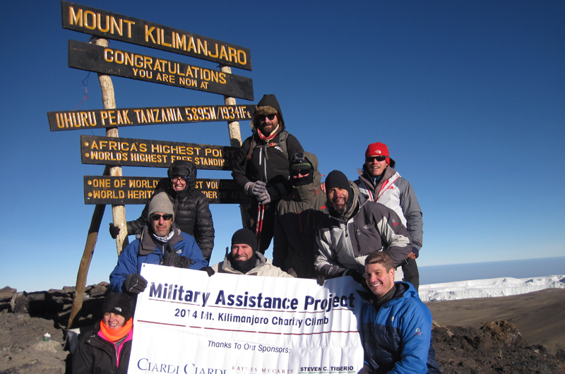 Chris Diaz, in the black hat on the right, with the Military Assistance Project climbing team on top of Mount Kilimanjaro.