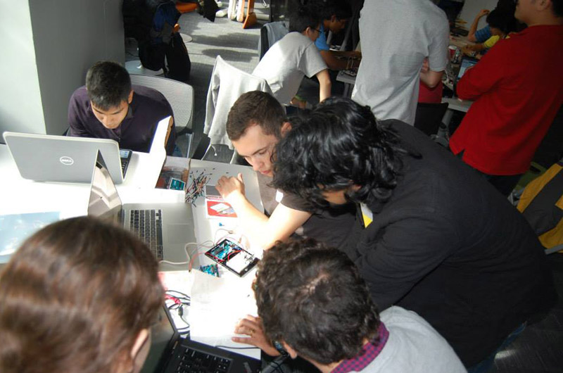 One of the teams working on their project during the 24-hour hackathon in the ExCITe Center.