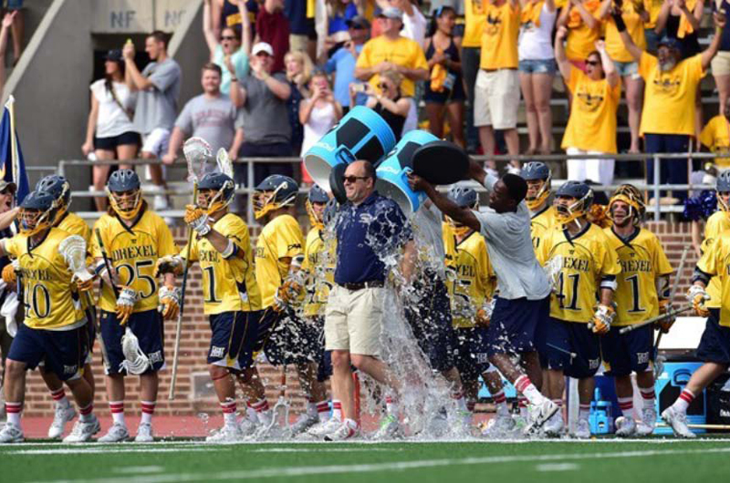 Drexel men's lacrosse celebrates its first-ever NCAA tournament victory by dumping Gatorade on coach Brian Voelker