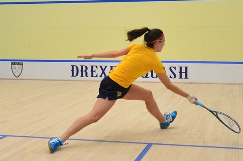 Women's squash player in action.