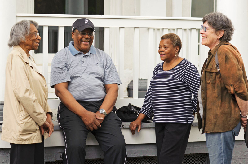 Members of the neighborhoods around the Dornsife Center, from left to right, Cora Conyers, Bishop Claude Barnes, Mae Barnes, and Helma Weeks. Photo by Jennifer Britton.