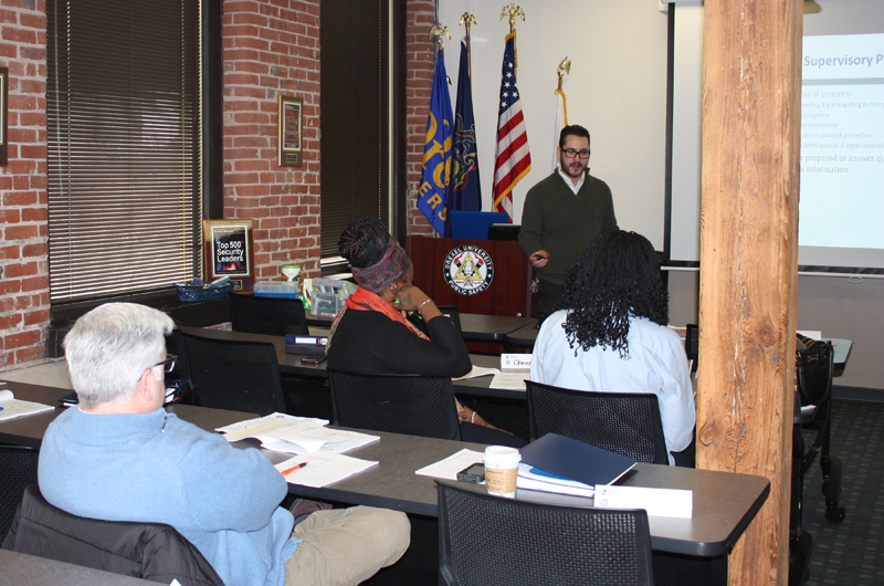 Colin Quinn instructing a class at the Drexel University Public Safety Communication Center (DUPSCC).