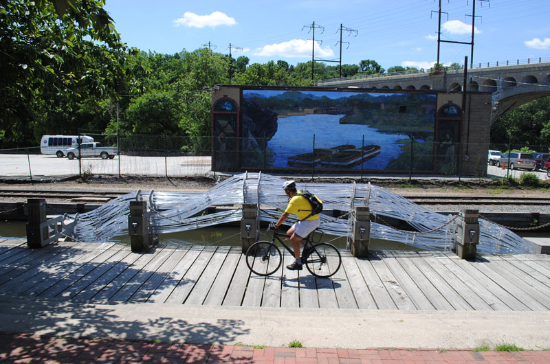 """Escaped Infrastructure"" at Canal View Park. Photo credit: Thoughtbarn, courtesy of the Mural Arts Program."