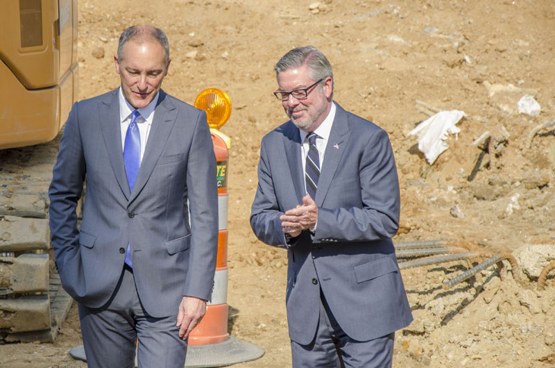 Drexel President John Fry and Paul McGrowan of The Study Hotels tour the site of teh future hotel on Drexel's campus
