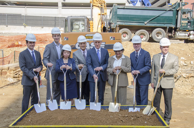 Group photo of groundbreaking for study hotel