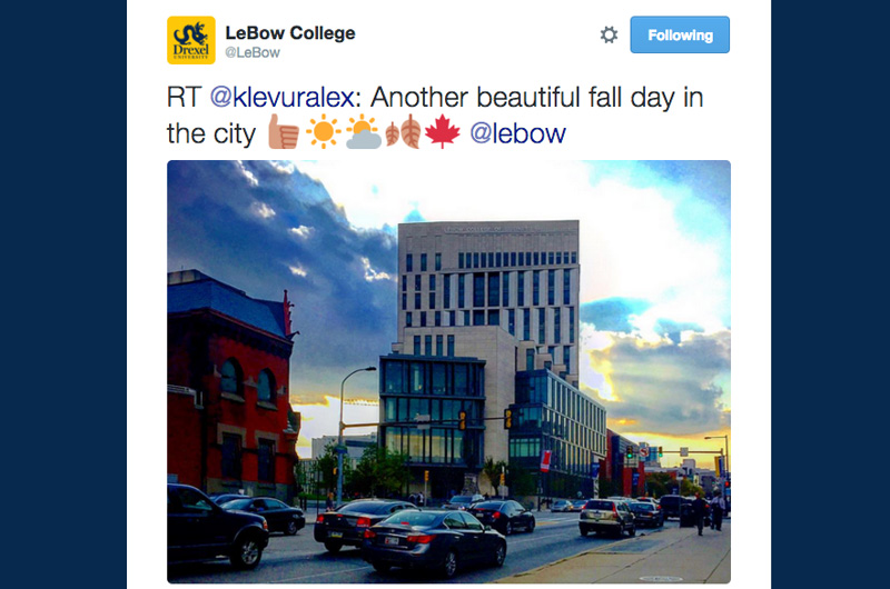 "A Tweet reading ""Another beautiful fall day in the city"" and Gerri C. LeBow Hall at twilight."