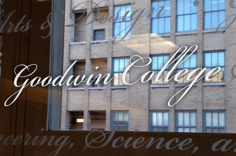 Goodwin College etched on glass in the Main Building.