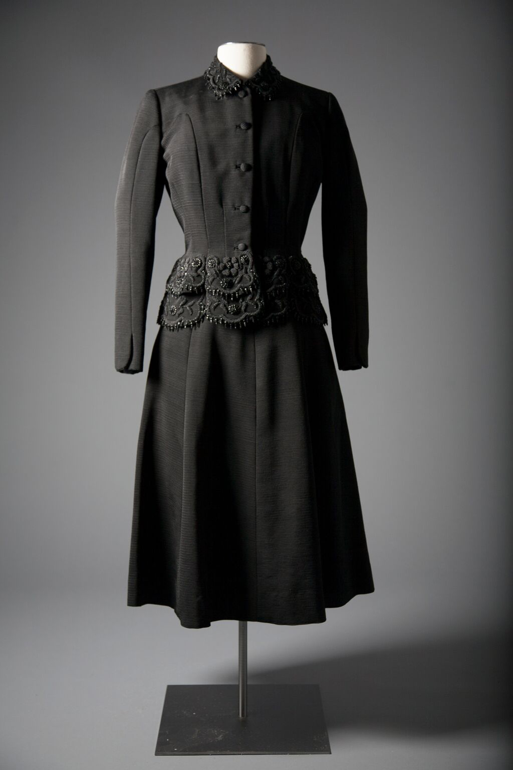 American beaded black cocktail suit, by Hattie Carnegie, fall/winter collection of 1949-50, a gift of Mrs. Walter Annenberg. Photo by Michael J. Shepherd.