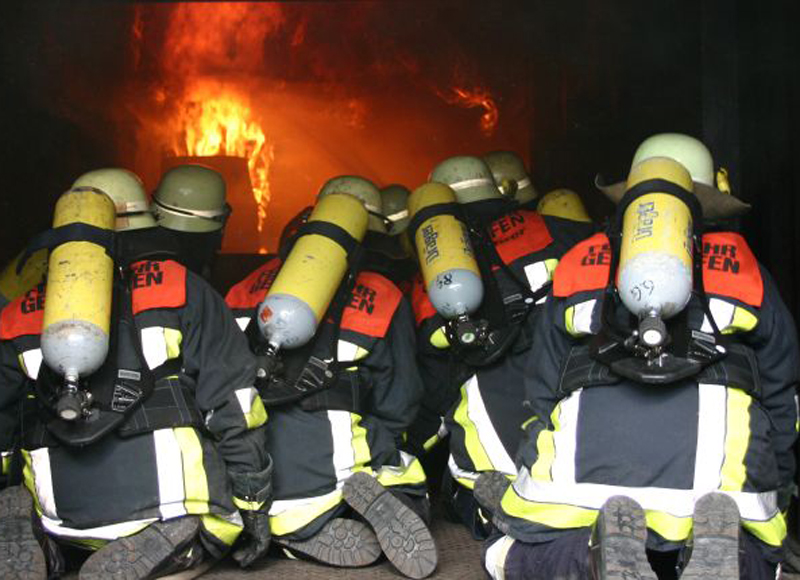 A team of firefighters wearing safety gear.
