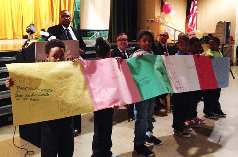 McMichael Students holding up posters as a thank you for Promise Neighborhood grant