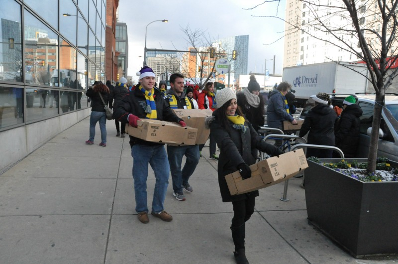 Volunteers carry turkeys to their recipients during the Turkey Project.