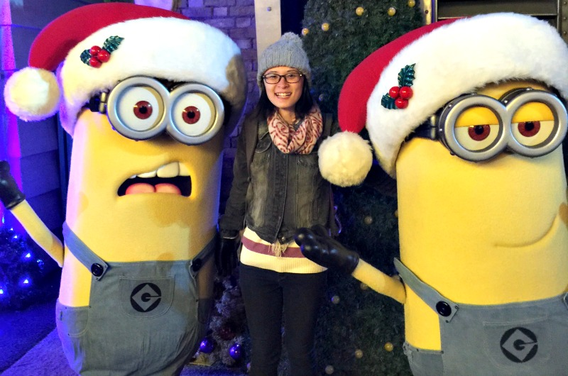 Danielle Chen poses with Minions from the Despicable Me franchise. Her co-op employer Hasbro makes many Minion-themed toys and games.