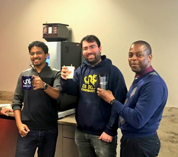 Engineering PhD students James and Cem enjoy the first cups of coffee in the suite with Director of Graduate Student Organizations Michael Ryan.