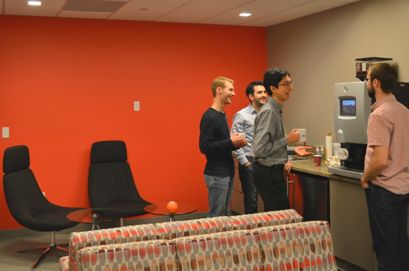 Graduate students enjoy coffee and conversation in the Graduate College's new space.