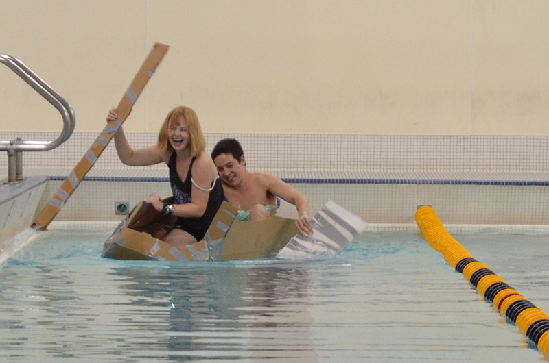 Samantha Haines and Riki McDaniel in their cardboard boat, the Tofu Eater