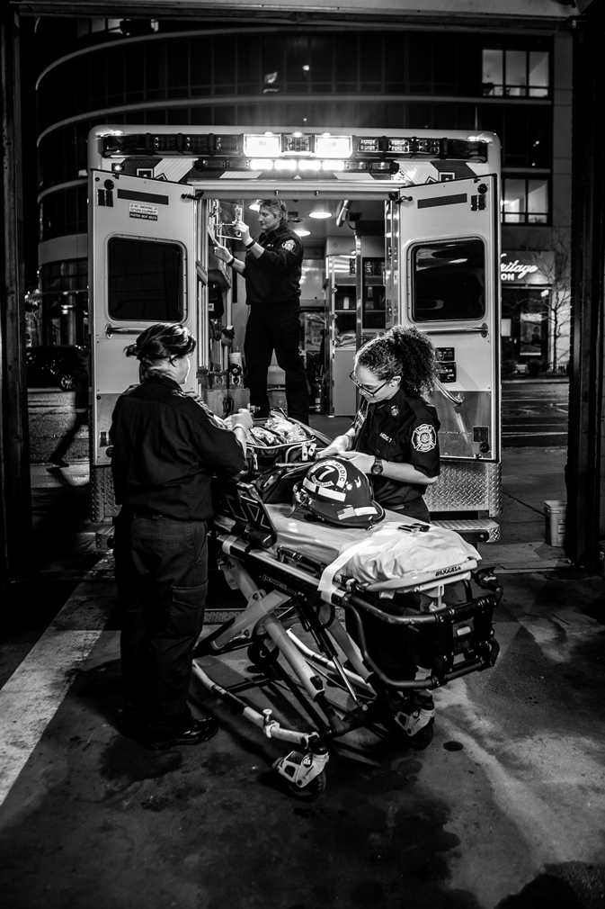 Ambulance crew getting a gurney ready for a call. Photo by Jeff Fusco.