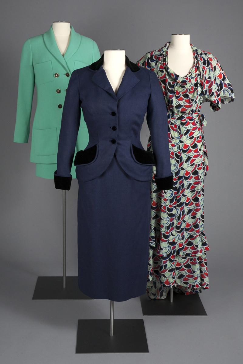 Skirt suits by Chanel and Dior, and a printed silk crepe evening dress from 1929.