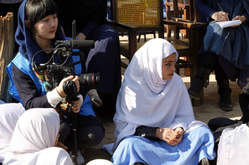 Lili Mao filming a documentary in Pakistan.