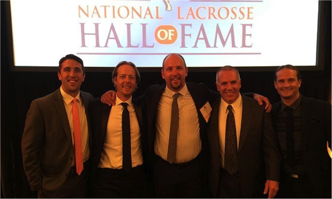 Drexel Men's Lacrosse Head Coach Brian Voelker, center, took his place among the greats in the sport as he was inducted into the National Lacrosse Hall of Fame.