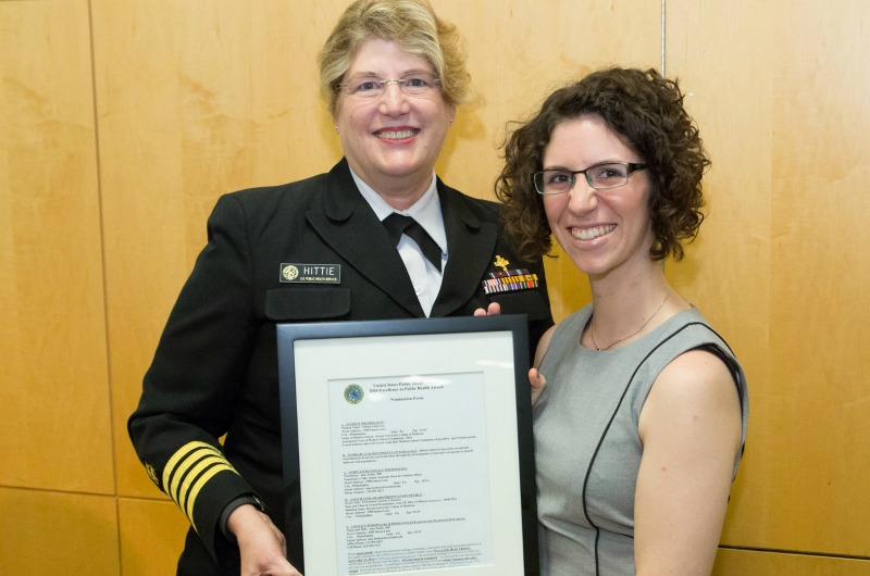 Allison Gutierrez, right, receives the United States Public Health Service Excellence in Public Health Award from Capt. JoAnne Hitte, an officer in the Commissioned Corps USPHS, on behalf of the Surgeon General of the United States.