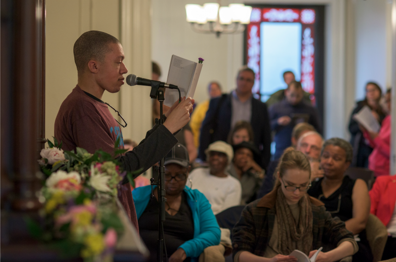 Writers Room participant Jordan McCullough reads to a crowd at last year's Writers Room anthology reading. Photo courtesy Jen Britton.