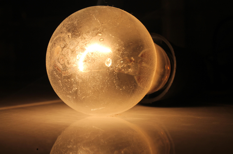 A lit light bulb.
