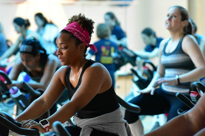 Participants in last year's Indoor Triathlon race to the finish line