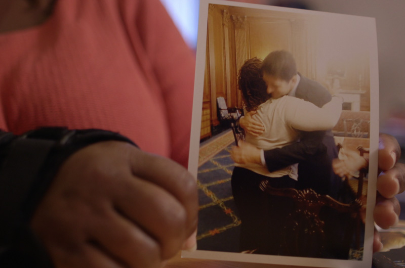 Tianna Gaines-Turner holds a photo of the hug she shared with Congressman Paul Ryan. Photo by Jas Borman.
