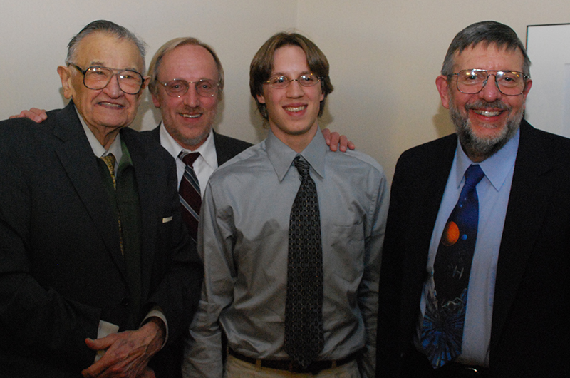 Left to right, Paul Kaczmarczik, Paul Michael Kaczmarczik and Mike Kaczmarczik pose with Nobel Laureate and 13th Kaczmarczik Lecture speaker William D. Phillips at the 2008 event.