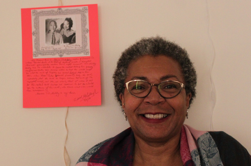 Carol Richardson McCullough standing with a piece she wrote as a part of Writers Room. Courtesy of Rachel Wenrick.