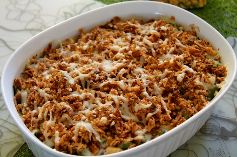 A green bean casserole made with fried onions and sprinkled cheese. Photo courtesy Flickr user Phil King.