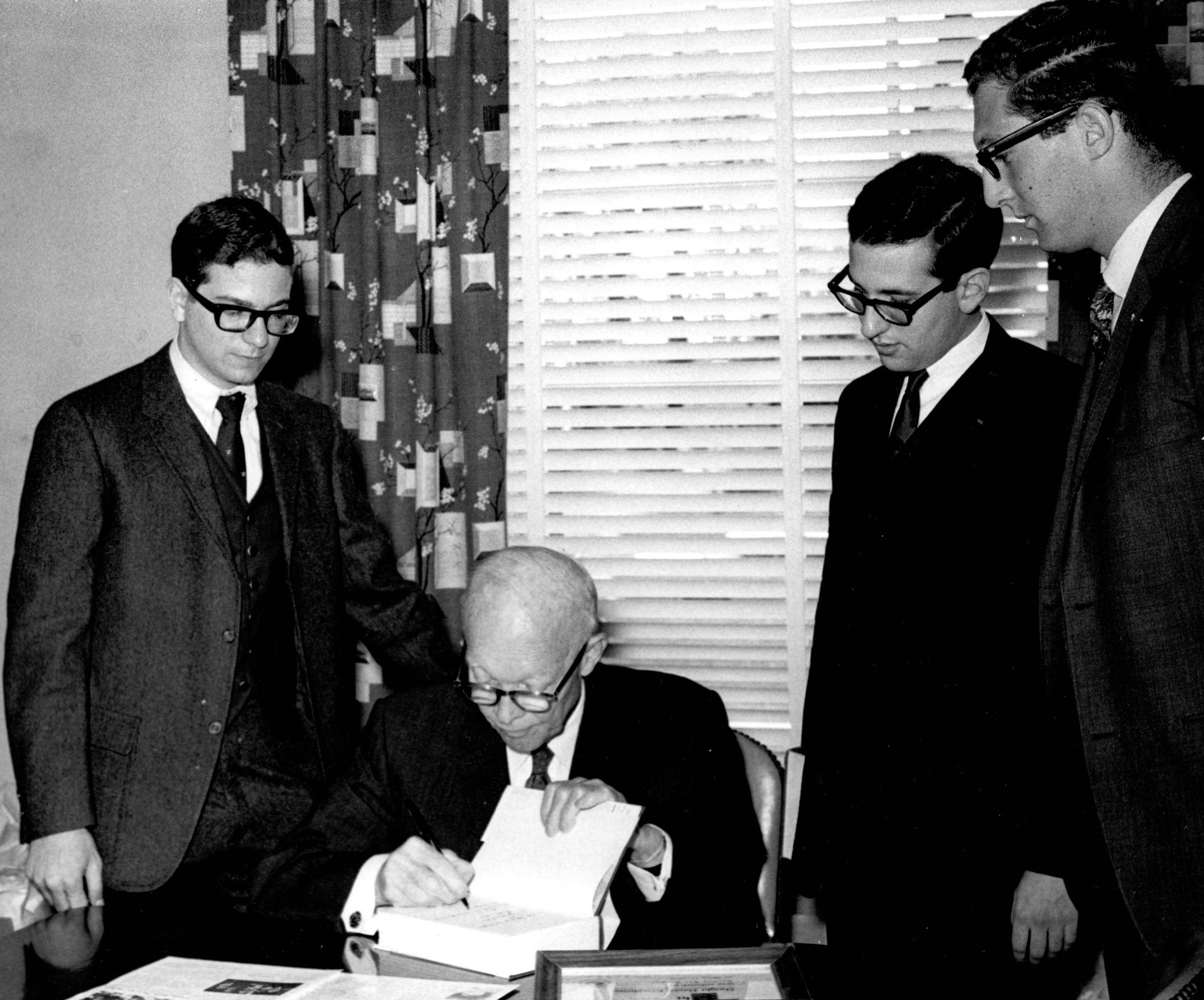 Dwight D. Eisenhower with Stan Abramson, Mike MarkowicH and Jeff Steinhorn while being presented Tau Epsilon Phi Distinguished American Award in 1967. Photo courtesy University Archives.