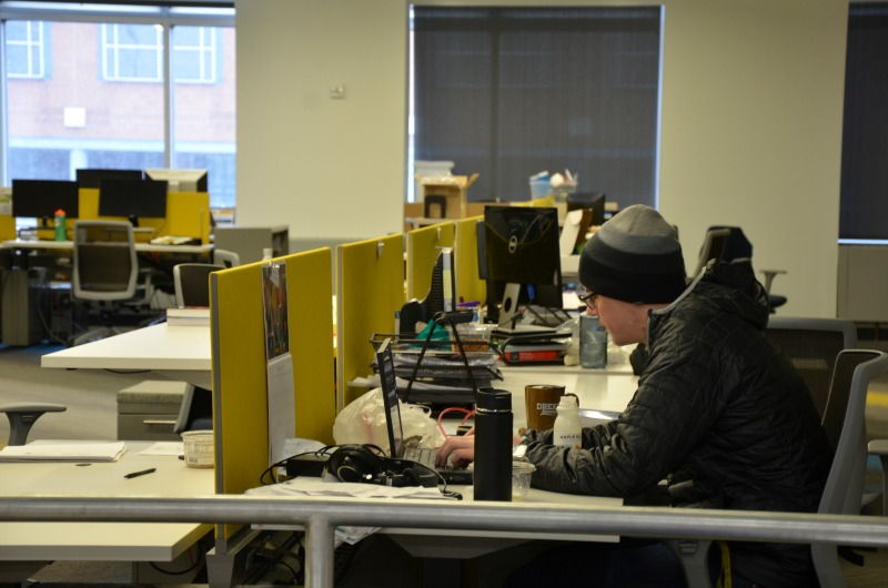 A student works at one of the workstations set up in the space.