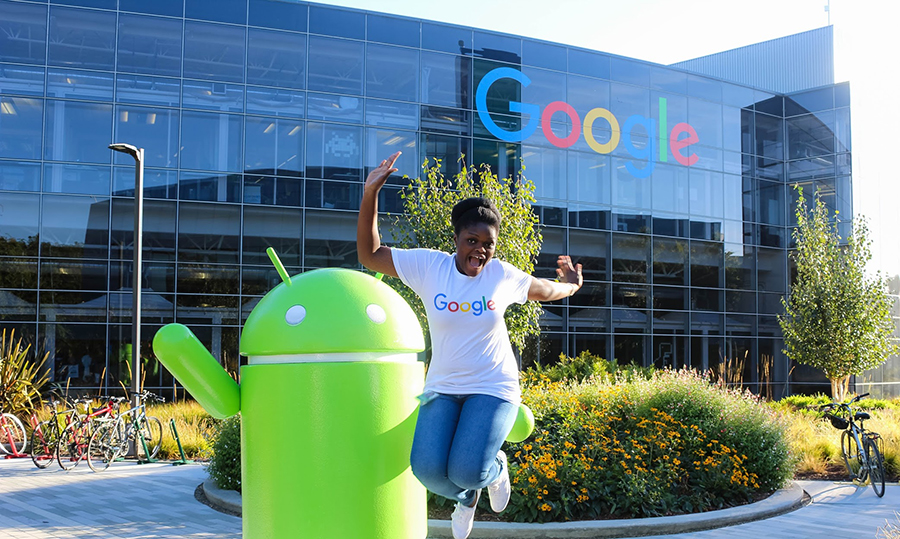 Samuella Takyi-Buachie (financing and marketing) jumps for joy during her co-op at Google's headquarters.