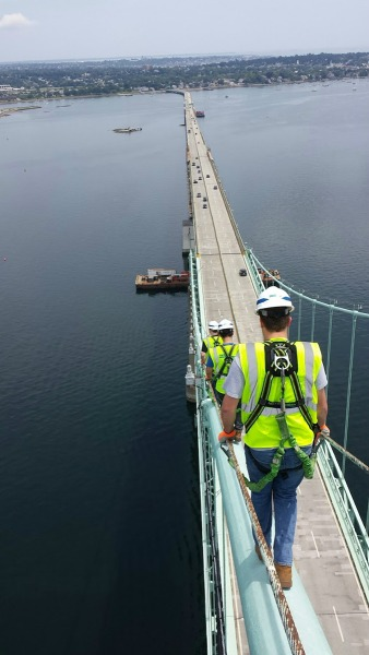 After conducting a bridge inspection, Tim Browne (mechanical engineering) walks down the cable of the Newport Bridge in Rhode Island.
